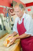 picture of turkey-cock  - Butcher preparing a chicken - JPG