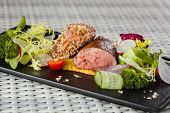 picture of veal  - Veal sauce with vegetables in a restaurant on a dark plate - JPG