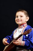 Smiling Boy With Balalaika