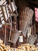 stock photo of adornment  - Baskets and Tools adorning the side of a traditional Swiss barn - JPG