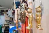 foto of paladin  - Wooden legs of an unfinished Sicilian puppet and their typical metal armor and shield in the studio of a marionette artisan in Ortigia Syracuse - JPG