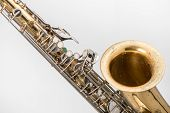 image of wind instrument  - Old saxophone isolated in white background,  music instrument. - JPG