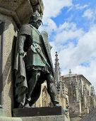 foto of trinity  - Statue of a medieval knight, in front of St. Trinity church, in Falaise, Normandy, France. ** Note: Shallow depth of field - JPG