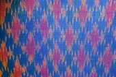 stock photo of thread-making  - pattern on silk for making a background image - JPG