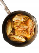 stock photo of chicory  - Side dish with fried chicory in sweet orange sauce perfect for fish and white meat - JPG