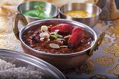 picture of curry chicken  - closeup of an indian chicken curry in a pot - JPG