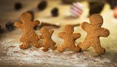 image of gingerbread man  - Gingerbread men made on the wooden table plate with gumdrops - JPG
