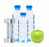 pic of bottle water  - Blue bottles with water chromed fitness dumbbells and green apple isolated on white background - JPG