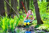 foto of wild adventure  - Child playing outdoors - JPG