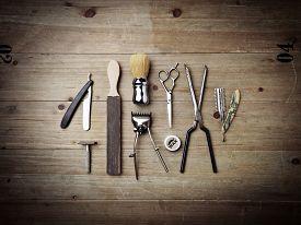 picture of barber razor  - Set of vintage barber tools on wood desk - JPG
