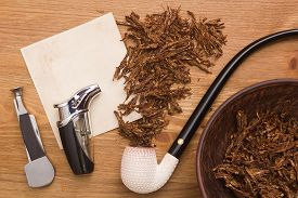 stock photo of tobacco-pipe  - Tobacco for pipe and pipe smoker tools and scraper.