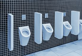 stock photo of urinate  - urinals in a public toilet - JPG