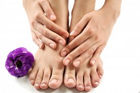 picture of pedicure  - Female feet at spa pedicure procedure with flower isolated on white - JPG