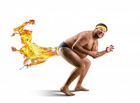 stock photo of queer  - Naked freak farts by fire - JPG