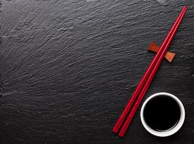 pic of soy sauce  - Japanese sushi chopsticks and soy sauce bowl on black stone background - JPG