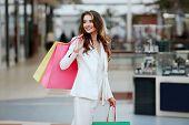 Beautiful Young Woman Doing Shopping poster