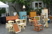 stock photo of cultural artifacts  - Vintage furniture lamps and picture frames at a local flea market - JPG