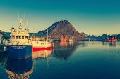 Fishing boats in harbor at midnight sun in Northern Norway, Lofoten Island, Ramberg, Norway - Mounta poster