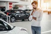 Man In Car Dealership poster
