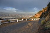 Famous Mulholland Hwy with thunder clouds and afternoon light.  High in the hills above Los Angeles