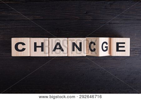 poster of Wooden Cube Flip With Word change To chance On Wood Table, Personal Development And Career Growt