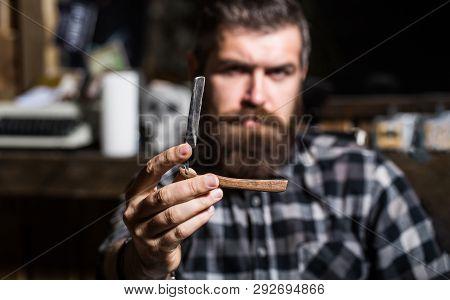Handsome Bearded Hairdresser Is Holding