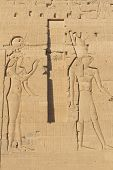 stock photo of isis  - Carving of Egyptian god on pylon in Temple of Isis at Philae Egypt - JPG