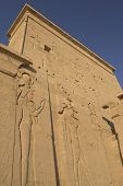 picture of isis  - Carving of Egyptian god on pylon in Temple of Isis at Philae Egypt - JPG