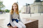 Cute Preteen Girl Sightseeing On The Streets Of Vilnius, Lithuania On Warm And Sunny Summer Day poster