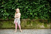 Cute Preteen Girl Sightseeing On The Streets Of Vilnius, Lithuania On Warm And Sunny Summer Day. poster
