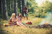 Fashion Women In Retro Dresses Relax At Bonfire. Happy Women With Blurred Man In Summer Forest. Beau poster
