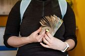 Photo Of Woman Holding In Hands Folded Bundle Of  Money In Cash Of Nepalese Rupees. Paying Bills Or  poster