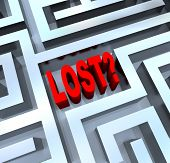 The word Lost in the middle of a maze or labyrinth symbolizing disorientation and not knowing where to turn, having lost your way