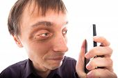 Ugly Weirdo Man Looking At Cellphone