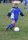 Youth Soccer Player Ready To Kick Ball