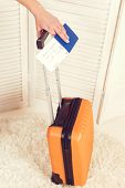 Close Up Woman Hand Holding Passport And Suitcase. Ready For Trip. Traveler And Lifestyle Concept. T poster