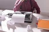 Vintage, Writer And Hipster Concept - Young Stylish Writer Working On Typewriter poster
