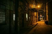 Vintage scary urban city alley at night in Chicago poster
