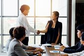 Group Of Business People In Corporate Meeting. Asian Smiling Happy Female Executive Shake Hands - Bu poster