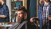 Barber With Clipper And Brutal Bearded Client. Hipster Client Getting Haircut. Hipster Lifestyle Con poster