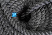 The Thick Black Rope Twisted In A Roll. The Top View On A Rope Spiral. The Rope Curtailed Into A Cir poster