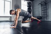Run As You Breath. The Athlete Trains Hard His Lower And Upper Body In The Gym, Doing Exercises For  poster