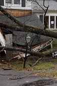 ANDOVER, NJ - OCT 30: A lamppost still standing in front of a tree laying across the front porch of
