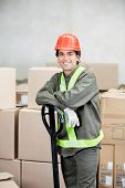 Portrait of young foreman standing at warehouse