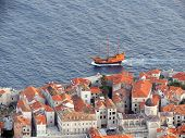 stock photo of galleon  - A wooden, galleon sailing through the Adriatic Sea past the ancient, historic walled city of Dubrovnik, Croatia