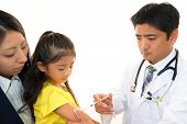 Doctor doing injection to girl