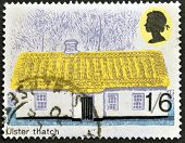 A stamp printed in Great Britain shows British Rural Architecture ulster thatch