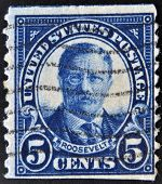 A stamp printed in USA shows Portrait President Theodore