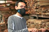 stock photo of masker  - Man at Lumber or timber with mask - JPG