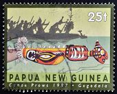 PAPUA NEW GUINEA - CIRCA 1997: A stamp printed in Papua shows canoe prows gogodala circa 1997